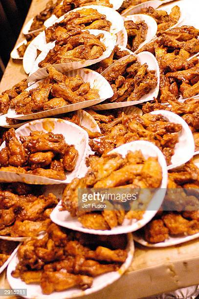 Buffalo Wings are stacked up before the competition begins at the 12th Annual Wing Bowl on January 30 2004 in Philadelphia Pennsylvania Over 15000...