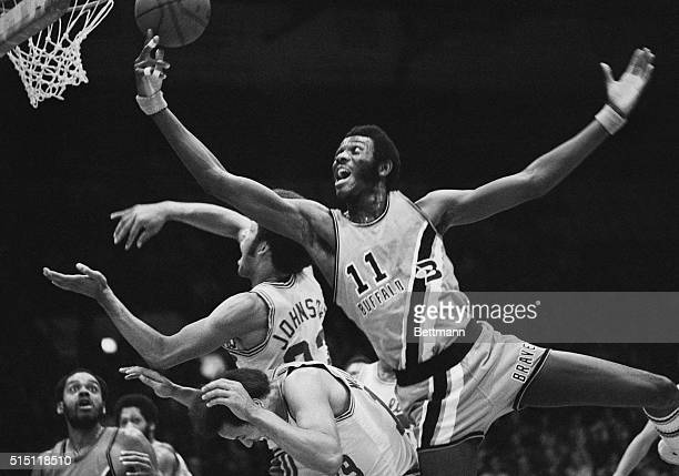 Buffalo's Bob McAdoo goes over Cavalier's Lenny Wilkens and John Johnson to score a basket during half play here on November 3rd The Cavaliers won...
