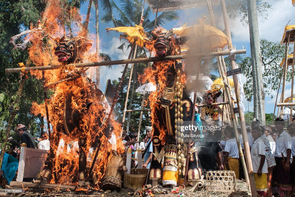 Buffalo-shaped sarcophagi burn during a Balinese Hindu mass cremation on August 18, 2013 in Ubud, Bali, Indonesia. More than 60 corpses were collectively cremated to share the expense of the ceremony. Well known as Ngaben, it is one of the most important ceremonies for Balinese Hindu people, as they believe it will free the spirit from the deceased body so it can reincarnate.