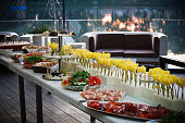 Buffet served table with snacks,fruits,canape,sweets and appetizers.Catering event plate service.Smorgasbord,food choice of breakfast in a restaurant