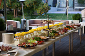 Buffet served table with snacks,fruits,canape,sweets and appetizers.Catering event plate service.Smorgasbord,food choice of breakfast in restaurant