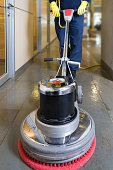 Industrial buffing machine polishing the floor in a hallway