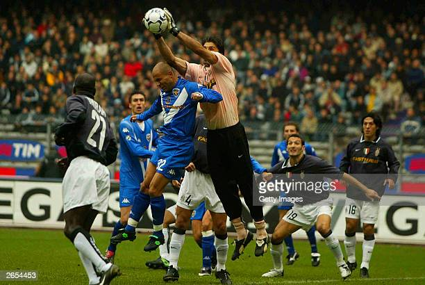 Buffon of Juventus and Di Biagio jump for the ball during the Italian A 7th round match between Juventus and Brescia at the Delle Alpi Stadium...