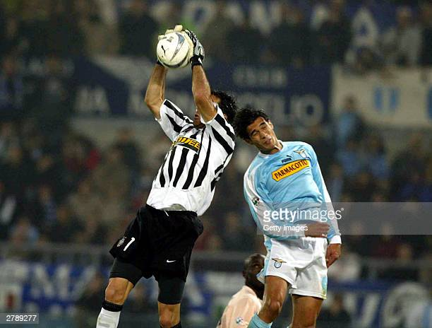 Buffon of Juventus makes a save against Corradi of Lazio during the Italian Series A 12th Round match between Lazio and Juventus at Olimpico Stadium...
