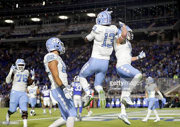 Bug Howard celebrates scoring a touchdown with teammate Austin Proehl of the North Carolina Tar Heels during their game at Wallace Wade Stadium on...