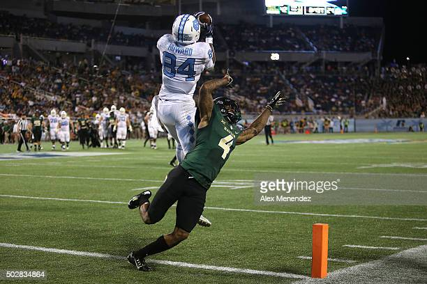 Bug Howard of the North Carolina Tar Heels catches a pass for a touchdown in front of Xavien Howard of the Baylor Bears during the NCAA Russell...