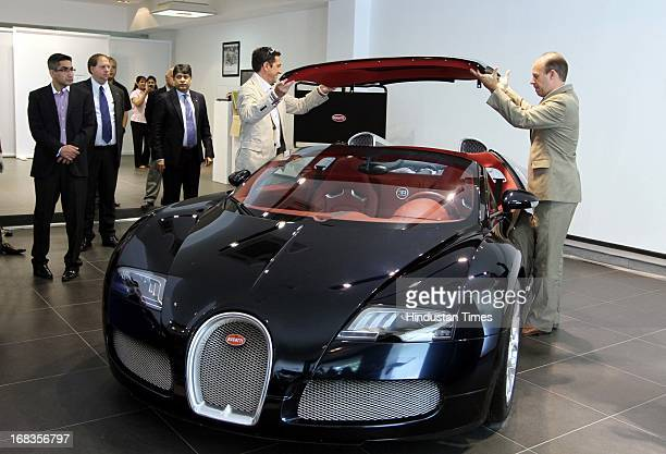 Bugatti Automobiles launch Bugatti Veyron 164 Grand sports car as others take out the convertible roof during its launch on October 28 2010 in New...