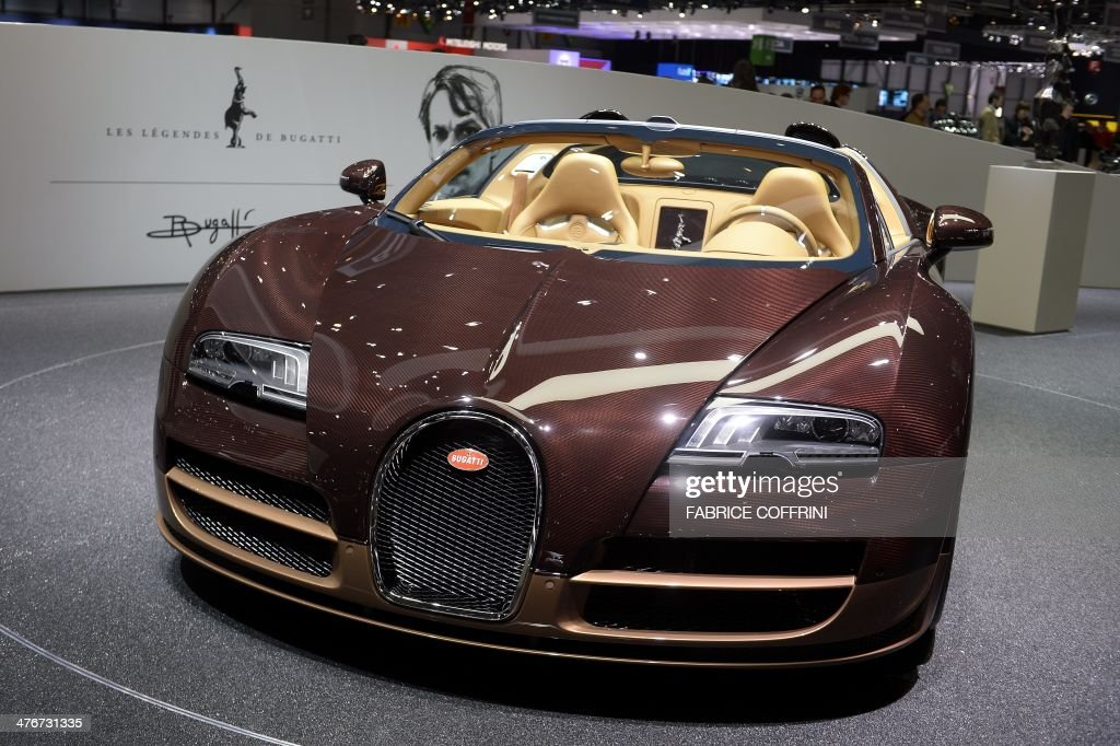 A Bugatti car is is displayed at the group's stand during the press day of the Geneva Motor Show in Geneva on March 5 2014 AFP PHOTO / FABRICE...