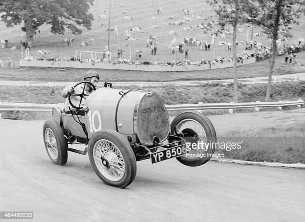 Bugatti T13 Brescia in action Prescott Hill Climb GloucestershireThe left front wheel of this Bugatti leaves the ground as the driver H Moffat...