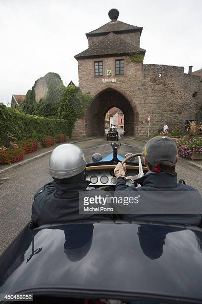 Bugatti type Brescia car navigates narrow streets in September 2013 in Molsheim FranceA group of Bugatti Brescia type 13 22 and 23 owners toured the...