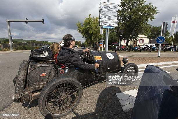 Bugatti type Brescia car navigates streets in September 2013 in Molsheim FranceA group of Bugatti Brescia type 13 22 and 23 owners toured the Alsace...