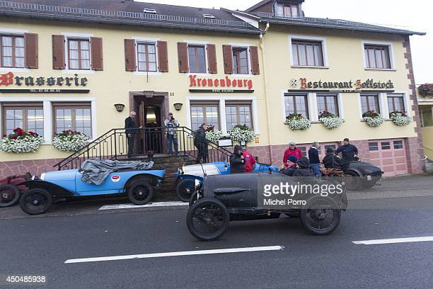 Bugatti type Brescia car navigates the streets in September 2013 in Molsheim FranceA group of Bugatti Brescia type 13 22 and 23 owners toured the...