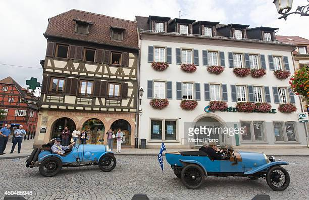 Bugatti type Brescia cars navigate streets in September 2013 in Molsheim France A group of Bugatti Brescia type 13 22 and 23 owners toured the Alsace...