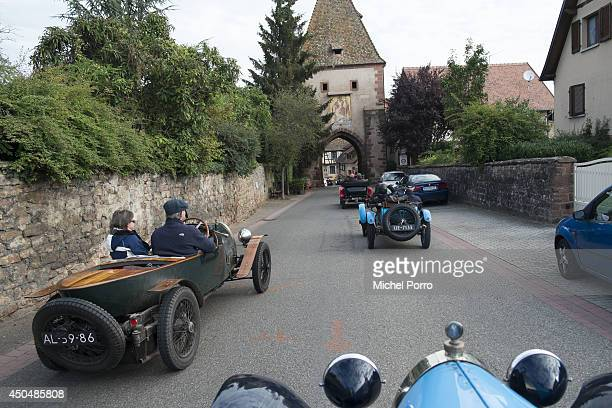 Bugatti type Brescia cars navigate the streets in September 2013 in Molsheim FranceA group of Bugatti Brescia type 13 22 and 23 owners toured the...
