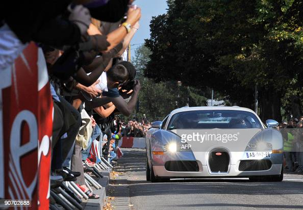 A Bugatti Veyron car parades in the streets of Molsheim near Strasbourg eastern France on September 13 2009 to commemorate the 100th anniversary of...