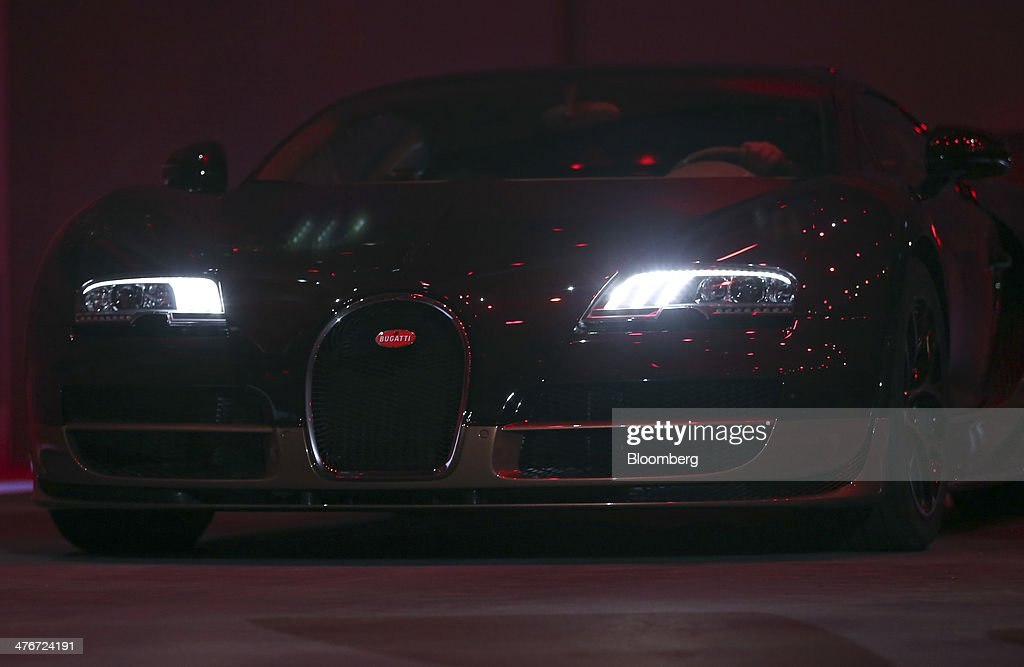 A Bugatti Veyron Rembrandt automobile produced by Volkswagen AG arrives on stage during its launch at a news conference ahead of the opening day of...