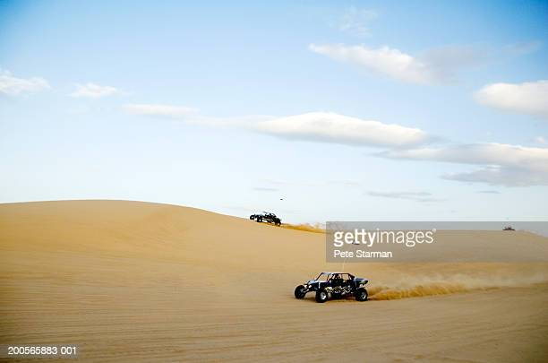 Buggy cars racing in desert