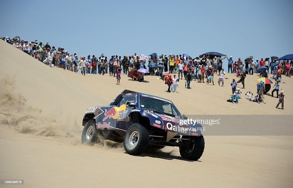 Buggy's driver Carlos Sainz of Spain arrives at the end of the Stage 2 of the Dakar 2013 in Pisco, Peru, on January 6, 2013. The rally will take place in Peru, Argentina and Chile from January 5-20.