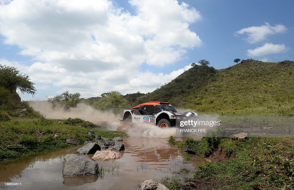 Buggy's driver Guerlain Chicherit of France competes during the Stage 9 of the Dakar 2013 between Tucuman and Cordoba, Argentina, on January 14, 2013. The rally takes place in Peru, Argentina and Chile between January 5 and 20. AFP PHOTO / FRANCK FIFE
