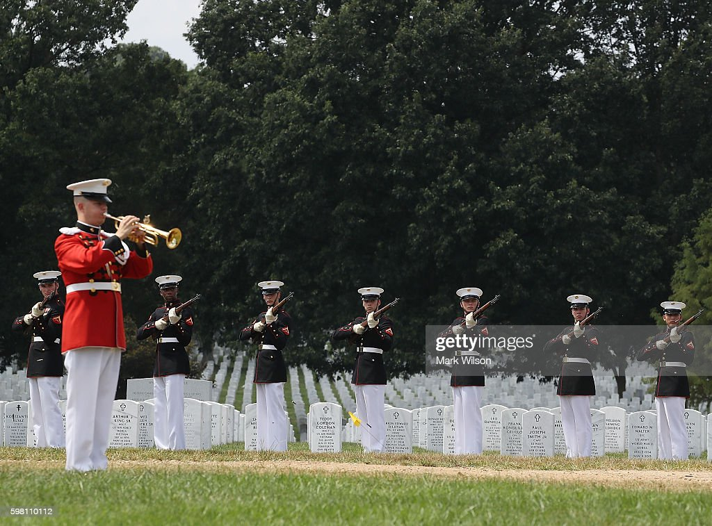 A buglar plays Taps during a full honors burial service for US Marine PFC Anthony Brozyna of Hartford CT at Arlington National Cemetary August 31...