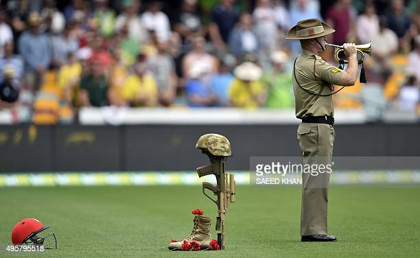 A bugler from the Australian Army plays to commemorate the 100th anniversary of the 1915 ANZAC landing at Gallipoli prior to the day one game of the...