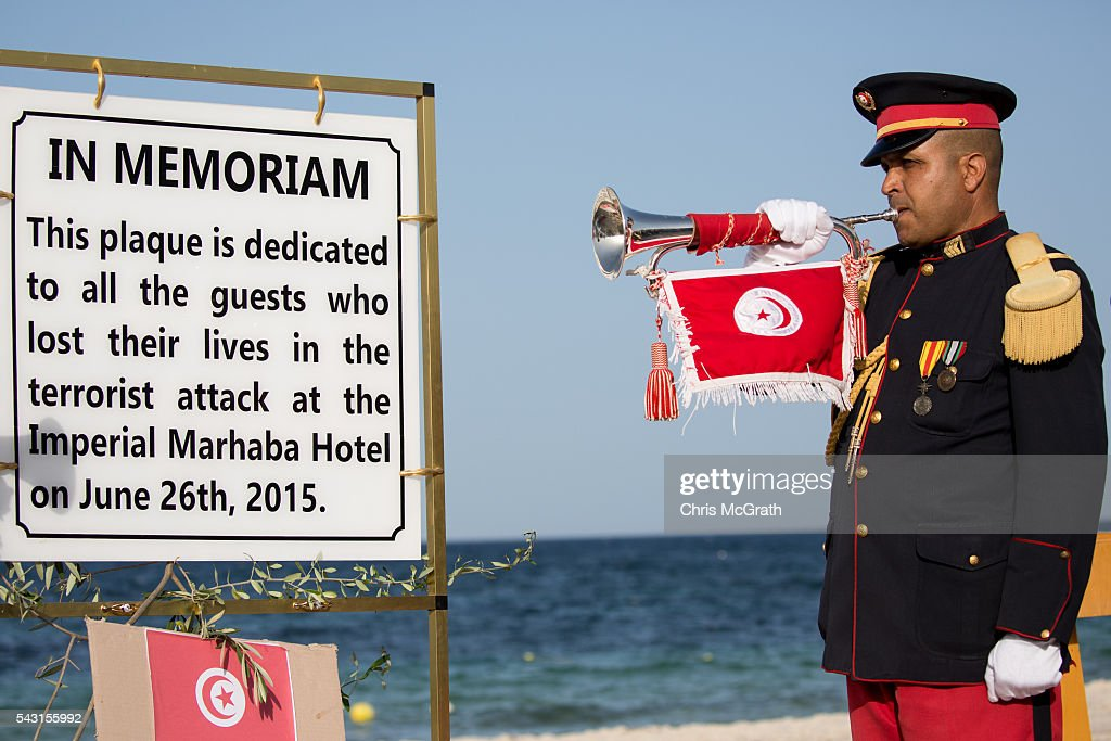 A bugler plays at the start of a memorial service for the victims of the 2015 Sousse Beach terrorist attack in front of the Imperial Marhaba hotel on June 26, 2016 in Sousse, Tunisia. Today marks the one year anniversary of the Sousse Beach terrorist attack, which killed 38 people including 30 Britons. Before the 2011 revolution, tourism in Tunisia accounted for approximately 7% of the countries GDP. The two 2015 terrorist attacks at the Bardo Museum and Sousse Beach saw tourism numbers plummet even further forcing hotels to close and many tourism and hospitality workers to lose their jobs.