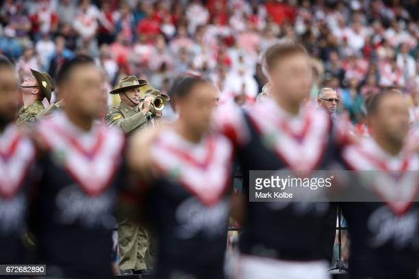 A bugler plays during the Anzac Day ceremony before the round eight NRL match between the Sydney Roosters and the St George Illawarra Dragons at...