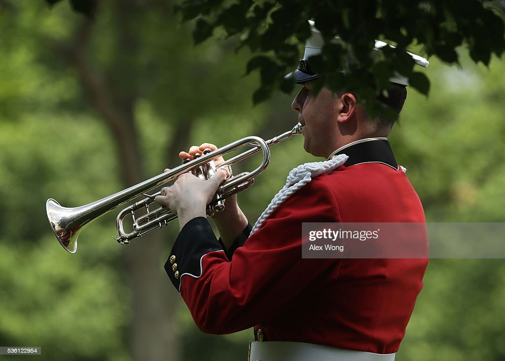 A bugler plays 'Taps' during the burial of Private First Class James Bernard Johnson May 31, 2016 at Arlington National Cemetery in Arlington, Virginia. Johnson was assigned to Company K, 3rd Battalion, 8th Marines, 2nd Marine Division during WWII. He died sometime on the first day of battle against the Japanese, November 20, 1943, in an attempt to secure the small island of Betio in the Tarawa Atoll of the Gilbert Islands after landing.