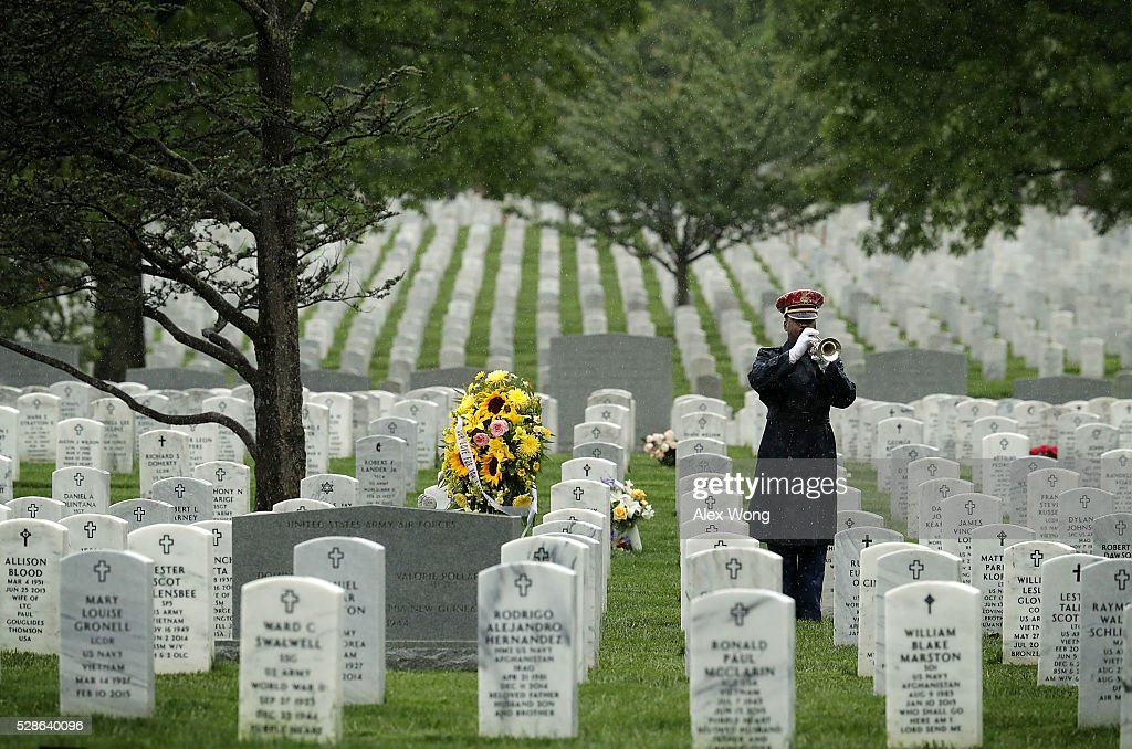 A bugler plays 'Taps' during the funeral of Army Corporal David J. Wishon at Arlington National Cemetery May 6, 2016 in Arlington, Virginia. Corporal Wishon was assigned to a medical unit in the 7th Infantry Division when he went missing after an attack on Dec. 1, 1950 in the Korean War.