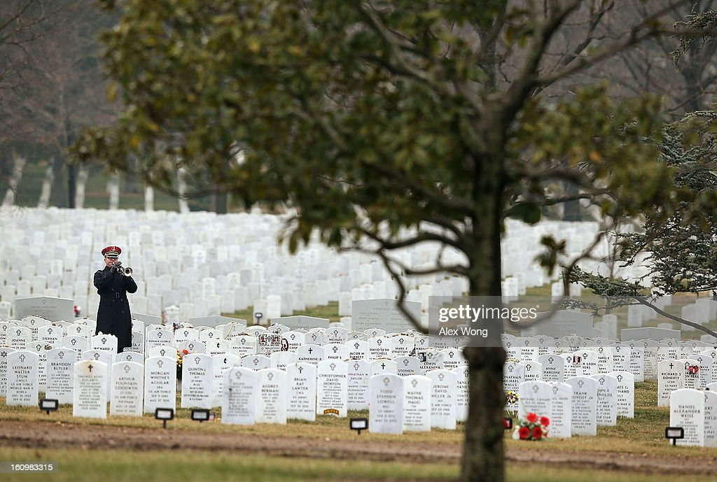 A Bugler plays 'Taps' during the funeral of Army Sergeant Aaron X. Wittman February 8, 2013 at Arlington National Cemetery in Arlington, Virginia. Sergeant Wittman, 28, of Chester, Virginia, was assigned to 3rd Battalion, 69th Armor Regiment, 1st Brigade Combat Team, 3rd Infantry Division in Fort Stewart, Georgia. He died on January 10, 2013 in Khogyani District of Nangarhar Province in Afghanistan, from injuries sustained after his unit was hit by a small arms fire.