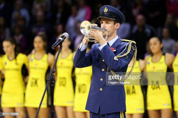 A bugler plays The Last Post in recognition of Anzac Day during the New Zealand Premiership match between the Pulse and the Mystics TSB Bank Arena on...