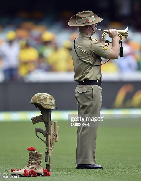 A bugler the from Australian Army plays to commemorate the 100th anniversary of the 1915 ANZAC landing at Gallipoli prior to the day one game of the...