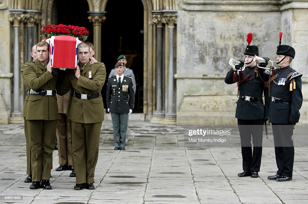 Buglers play The Last Post as WW1 veteran Harry Patch's coffin is carried by 6 soldiers from 1st Battalion The Rifles from Wells Cathedral after his...