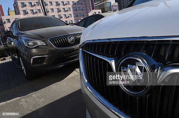 Buick cars are parked outside a Buick showroom in Beijing on December 15 2016 Chinese antitrust officials are investigating General Motors in the...