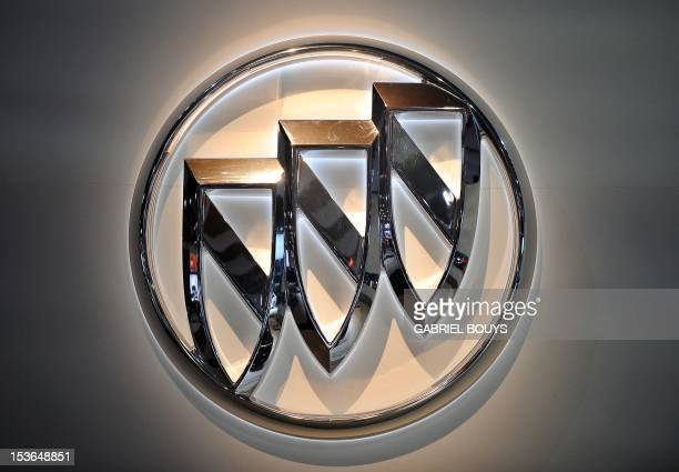 A Buick logo is seen during the press day of the LA Auto Show in Los Angeles California on November 18 2010 AFP PHOTO / GABRIEL BOUYS