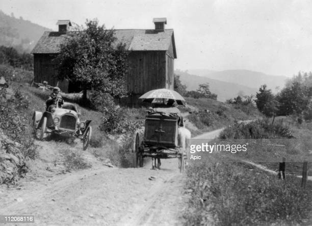 Buick roadster waits for horsedrawn wagon to pass on narrow country road above Liberty NY 1912