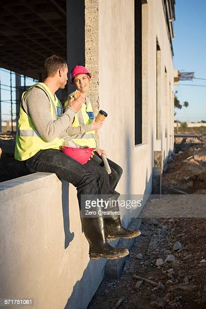 Builder and architect taking a coffee break on construction site