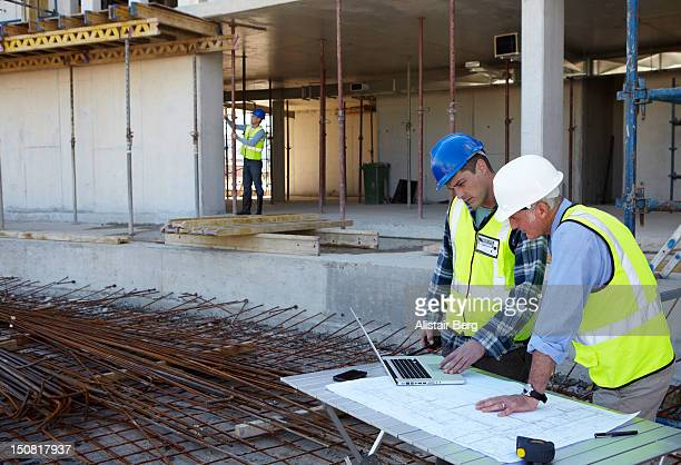 Builder and civil engineer working on site