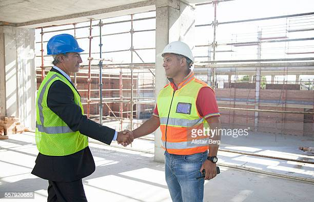 Builder and client on construction site