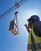 Builder Guiding a Crane