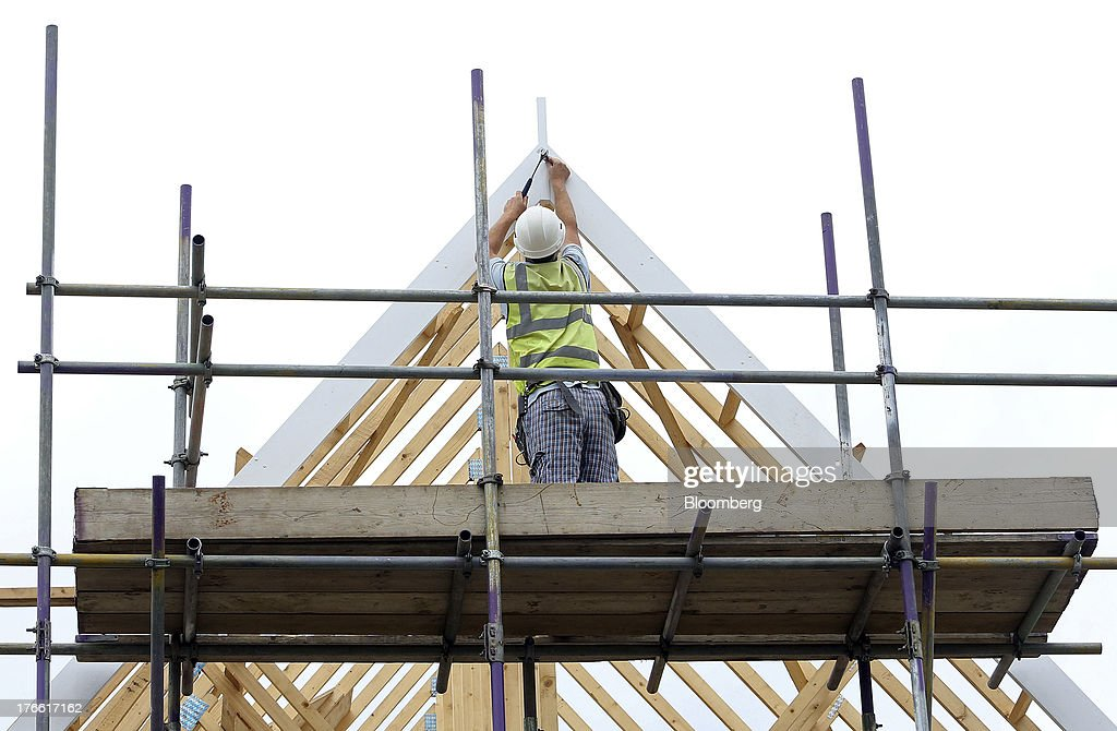 A builder hammers a nail into the gable end of a house during construction at a Persimmon Plc residential housing site in Rainham, U.K., on Friday, Aug. 16, 2013. Persimmon, the largest homebuilder by market value, said in July that its operating margin widened to about 15 percent during the half from 12.1 percent. Photographer: Chris Ratcliffe/Bloomberg via Getty Images