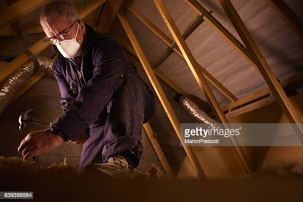 builder laying attic flooorbaord