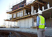 Builder looking at unfinished office block