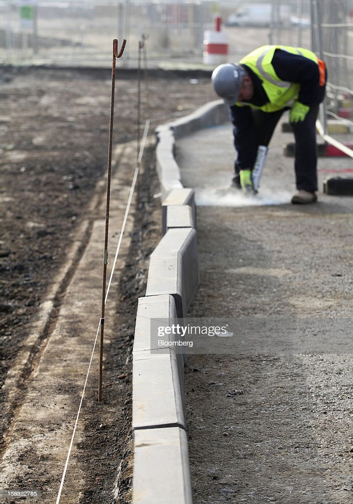A builder marks the position of underground pipework at a Barratt Developments Plc construction site for residential housing in Bedford, U.K., on Thursday, Dec. 13, 2012. Barratt Developments Plc, the U.K.'s largest homebuilder by volume, said advance sales rose 21 percent as government initiatives to boost homebuilding lifted private reservations in the autumn selling season. Photographer: Chris Ratcliffe/Bloomberg via Getty Images