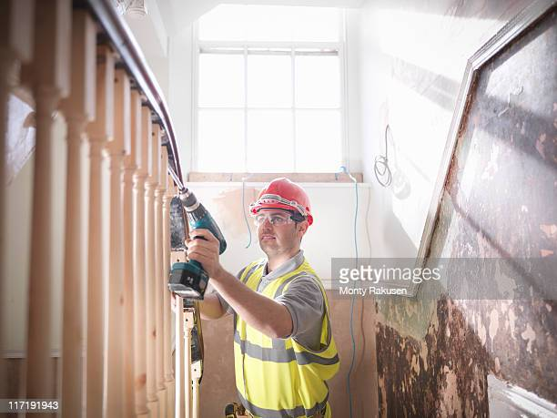 Builder renovating staircase