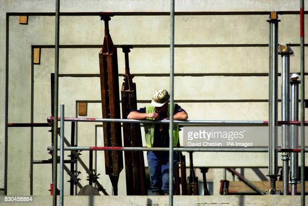 A builder takes a break from the building of the Holyrood parliament in Edinburgh Scotland's Auditor General Robert Black presented his report on the...