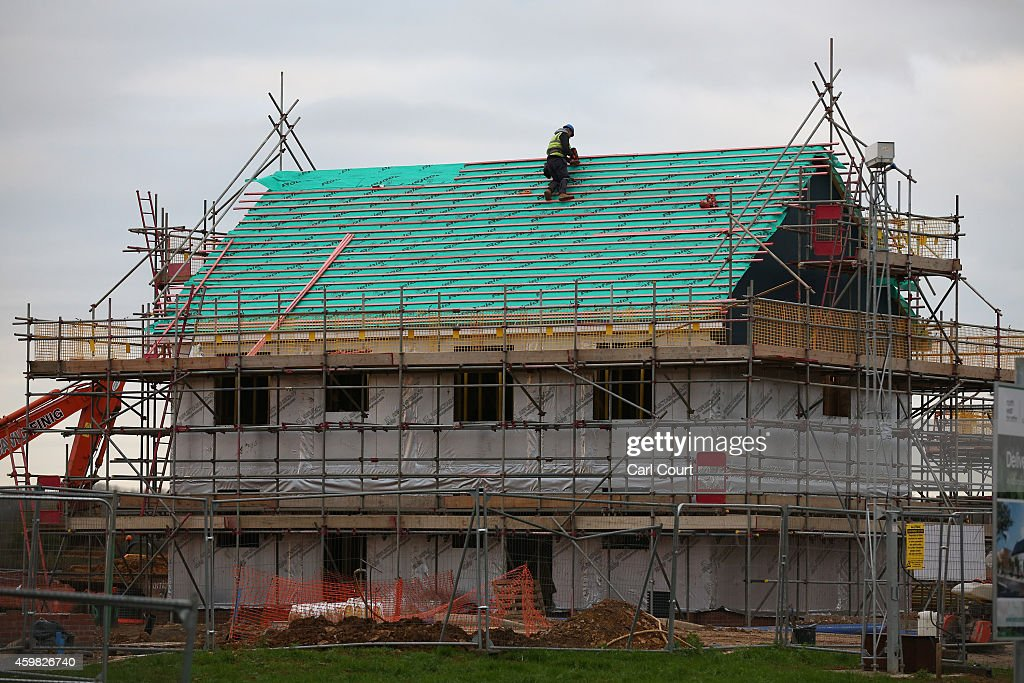 A builder works on a house on the site of the first ecotown in the United Kingdom is pictured on December 2 2014 in Bicester England Up to 13000 new...