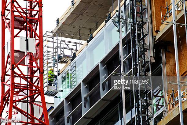 A builder works on an office construction site at Roche Holding AG's headquarters in Basel Switzerland on Wednesday Jan 29 2014 Roche Holding AG...