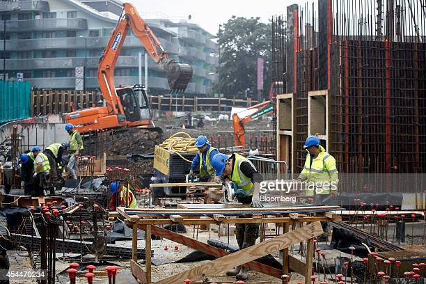 Builders and carpenters work on the footings of a new phase of the Wembley Park retail and residential complex a joint development venture by...