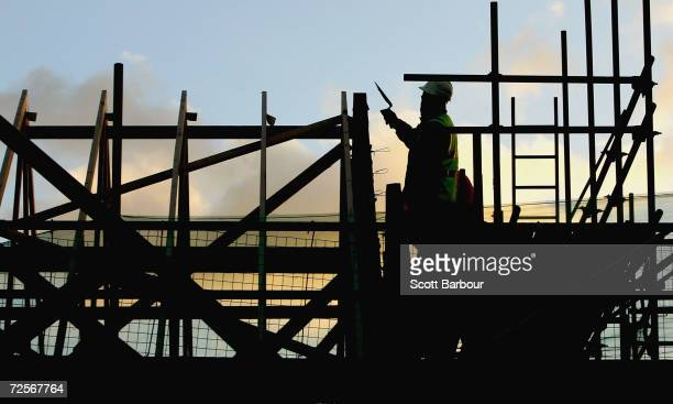 Builders at work on a new housing development site on January 24 2005 in Kent England Britain's Deputy Prime Minister John Prescott will today...
